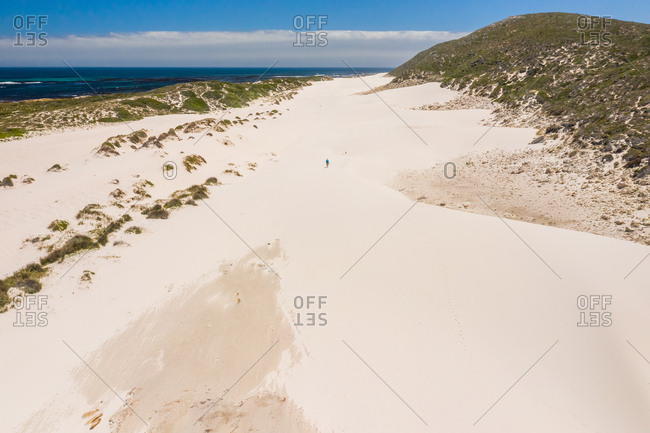 Aerial view of man walking at Platboom beach during the day, South Africa.