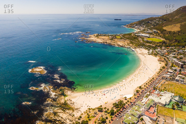 Aerial view of people enjoying sunny day at Camps Bay beach, South Africa.