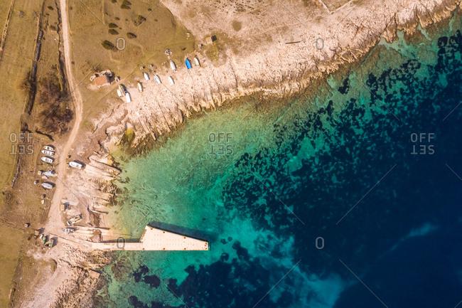 Aerial view of boat pier at Otok Vele Srakane island, Croatia.