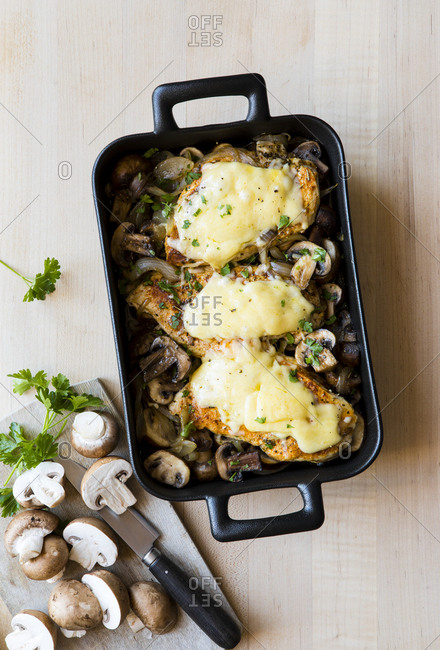 Baked chicken casserole with mushrooms