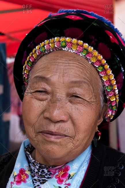 March 14, 2019: Elderly Bai ethnic minority woman in Xizhou village, Yunnan, China