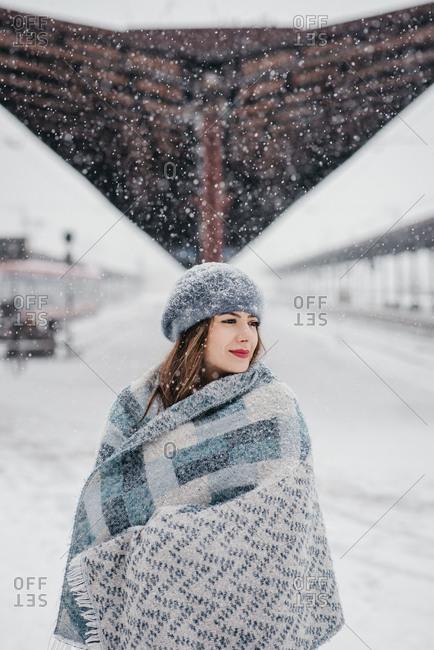 Pretty young woman among beautiful snowy scenery