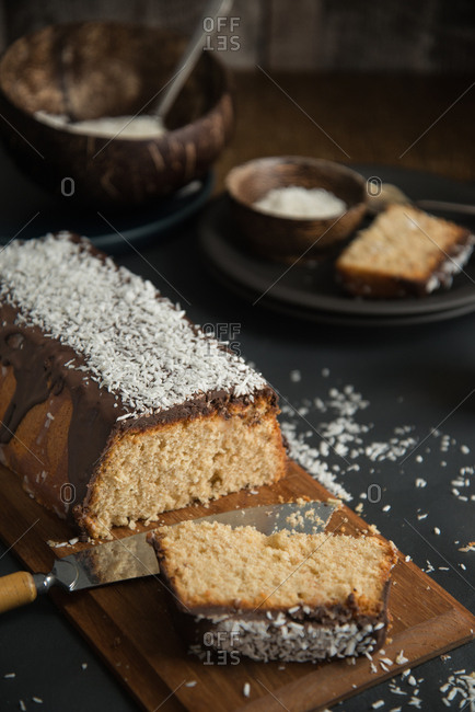 Coconut pound cake glazed with chocolate and coconut rasp, ready to be shared
