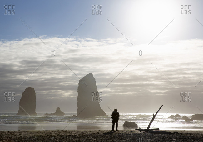Old man in cowboy hat enjoying the view at Cannon beach, Oregon, USA