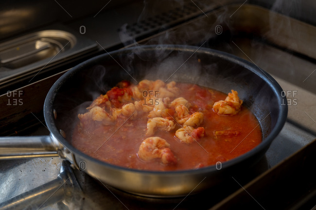 Shrimp and tomato mixture simmering in a pan