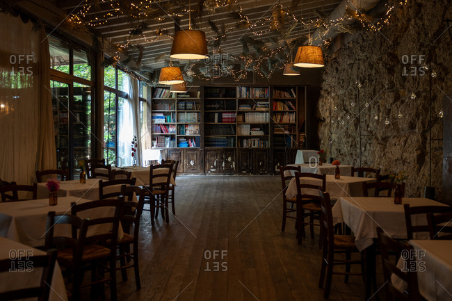 Franciacorta, Italy - September 15, 2019: Rustic interior of a quaint restaurant with stone wall