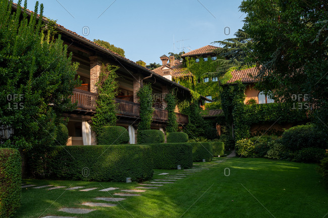 Franciacorta, Italy - September 15, 2019: Exterior of a large villa surrounded by lush green foliage