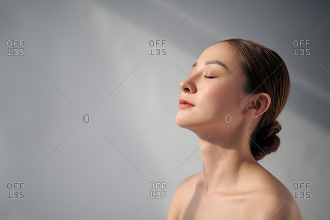 Beautiful woman relaxing with her eyes closed