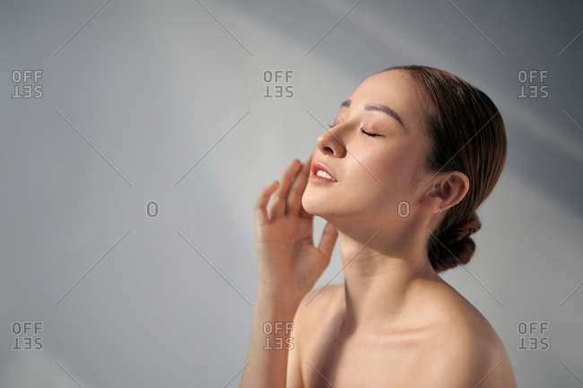Beautiful Asian woman relaxing with her eyes closed