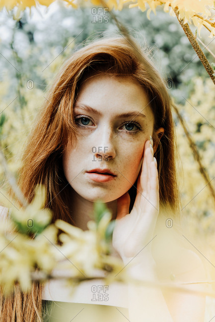 The fashion portrait of young redhead ginger woman in stylish look in the park