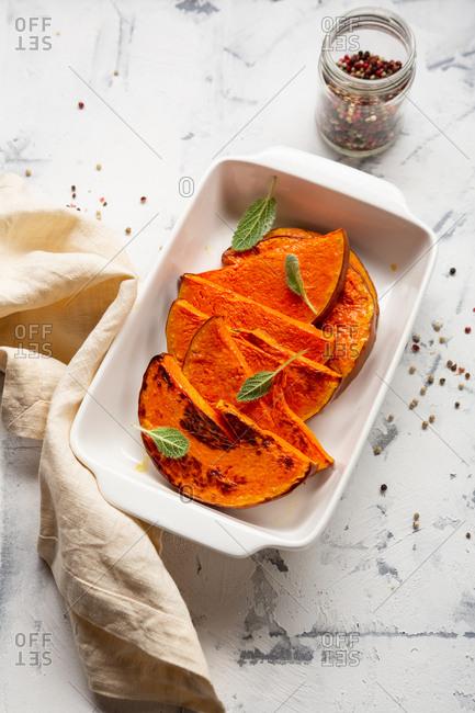 Baked pumpkin slices garnished with sage