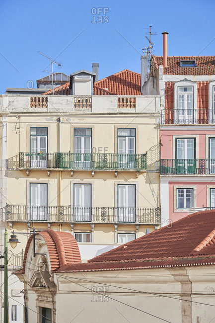 Lisbon, Portugal - November 21, 2019: Multicolored facades of buildings with balconies