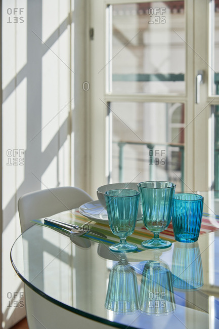Table set with white dishes and blue glasses, Lisbon, Portugal
