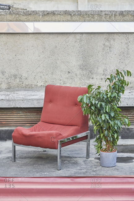 Old red chair on a terrace, Lisbon, Portugal