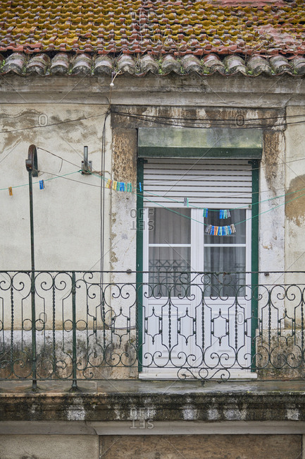 Door and balcony on an old weathered building, Lisbon, Portugal