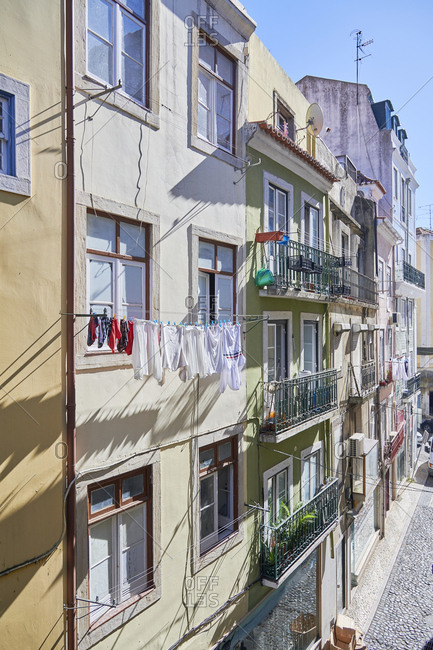 Lisbon, Portugal - October 25, 2019: Laundry hanging from apartment balconies in the Mouraria District