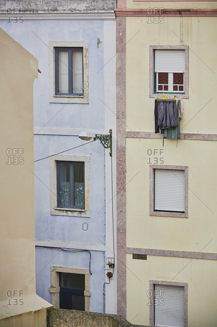Apartment building in Lisbon, Portugal with laundry hanging from window