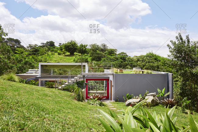 Costa Rica, Central America - July 30, 2019: Exterior of modern home in beautiful green countryside