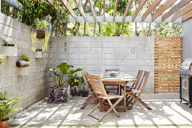 Costa Rica, Central America - July 31, 2019: Outdoor dining table under pergola