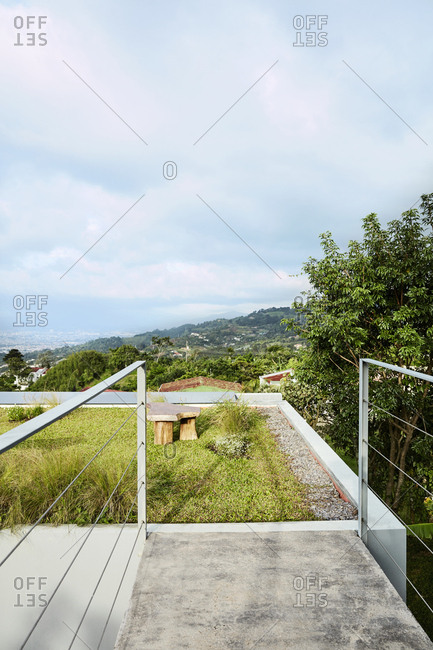 Costa Rica, Central America - July 30, 2019: Grassy rooftop on modern home overlooking hillside