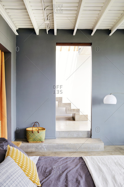 View from a bedroom to steps inside a modern Costa Rican home