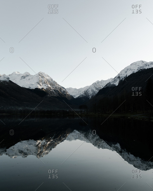 Snowy lake in winter in the French Pyrenees, sunset, reflection