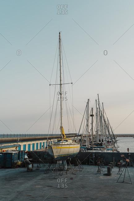 Spain- Province of Barcelona- El Garraf- Yachts moored in shipyard harbor