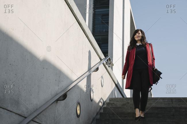 Modern businesswoman going to metro station
