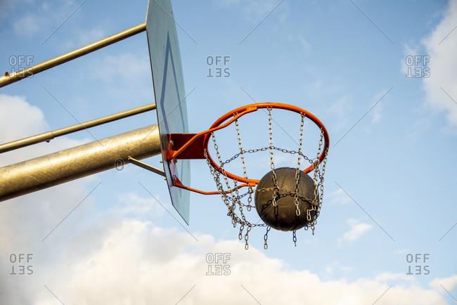 Basketball ball in the basketball hoop