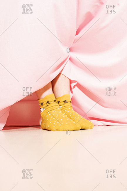 Feet of a little girl wearing dotted socks