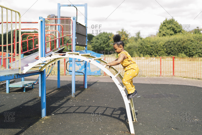 Girl climbing up a ladder on a playground