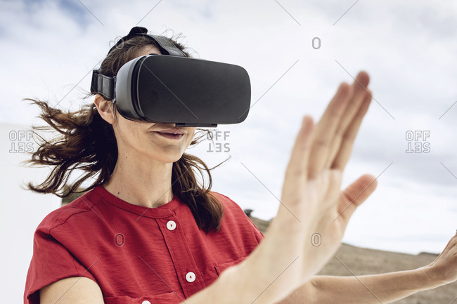 Mature woman wearing VR goggles