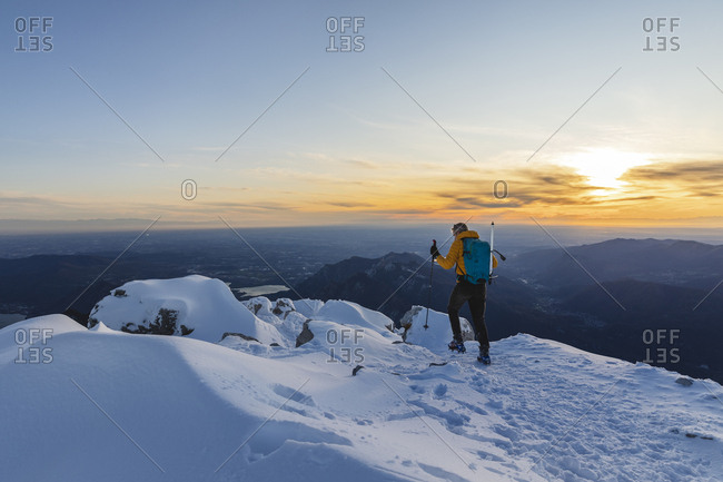 Mountaineer walking on top of a snowy mountain- Lecco- Italy