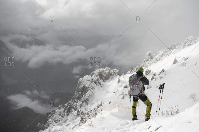 Mountaineer looking at distance- Italian Alps- Lecco- Lombardy- Italy