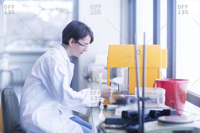 Female chemist at work