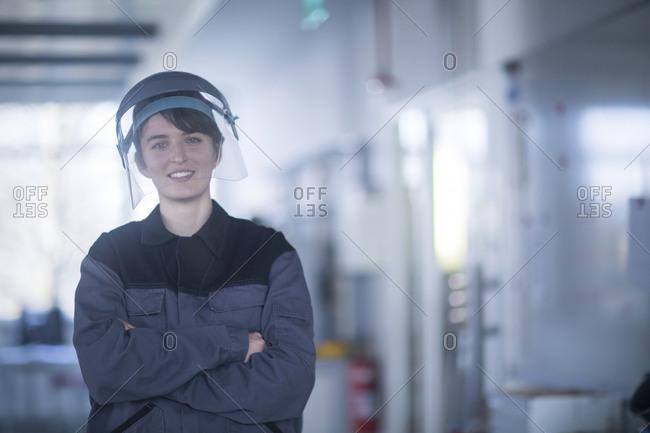 Portrait of female technician wearing safety helmet