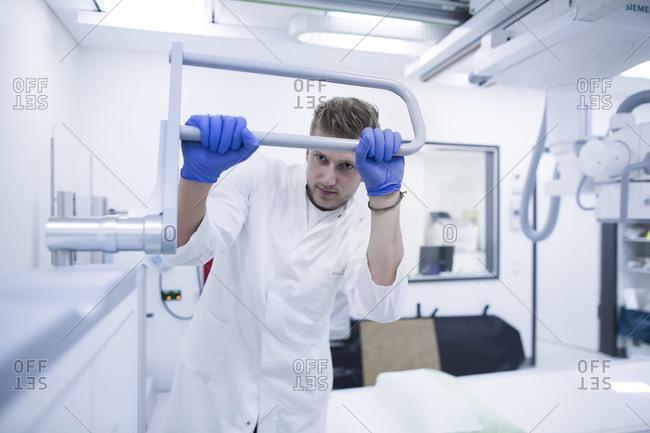 Radiologist adjusting a x-ray machine in a hospital