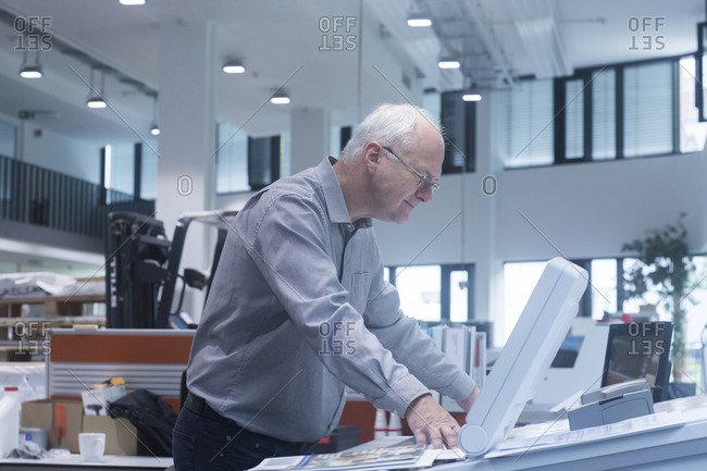 Manager working in printing house