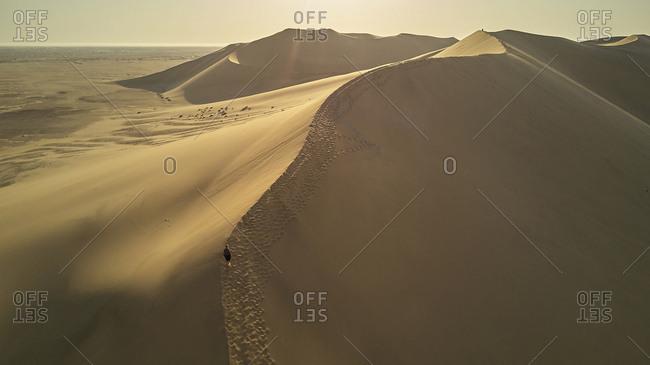 Woman in dune landscape- Namib Desert- Namibia