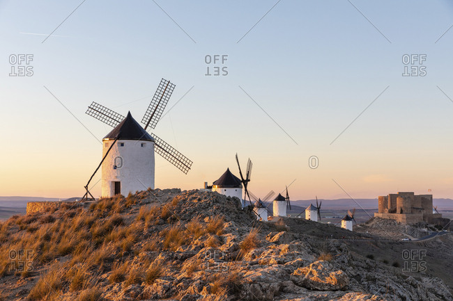 Spain- Province of Toledo- Consuegra- Row of old windmills standing on top of hill