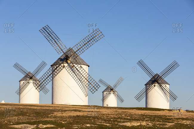 Spain- Province of Ciudad Real- Campo de Criptana- Countryside windmills standing against clear sky