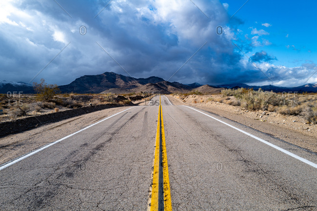 An empty road in the Mojave desert near Cima, California