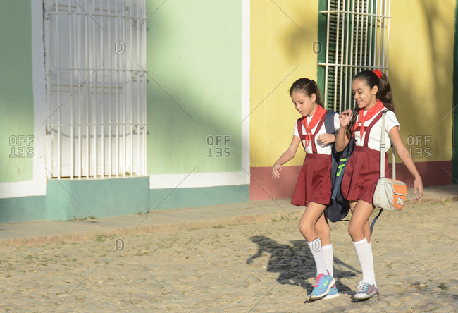Schoolgirls walking in Trinidad, Cuba