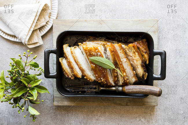 Sliced pork roast in roasting pan