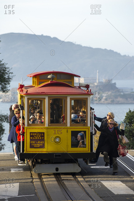San Francisco, California - March 24, 2013: Cable Car at Powell and Hyde with Alcatraz Island in background