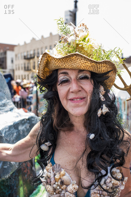 Brooklyn, New York - June, 22, 2019: Woman dressed in costume with shells for the 37th Annual Mermaid Parade, Coney Island