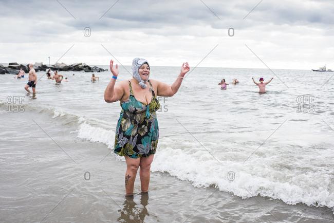 Brooklyn, New York, USA- January 01, 2020: Woman on beach during the New Year's Day Polar Bear Plunge, Coney Island, Brooklyn