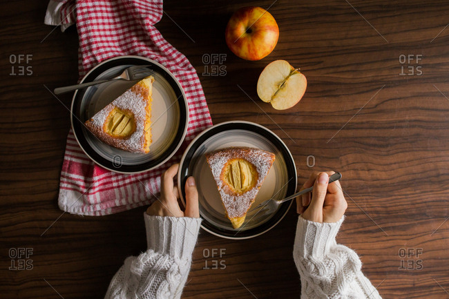Overhead view of woman eating apple pie