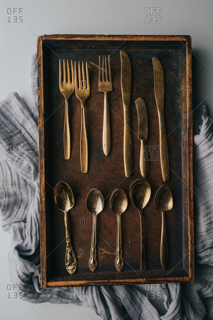 Collection of vintage silverware in a wooden box
