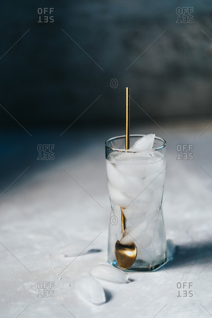 Tall glass of water with refreshing ice